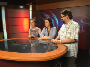 Jill O'Brien, left, and Ally Schidhammer take a turn on the anchor desk in the Williams Hall TV studio, with an assist from MJF Chief Engineer Steve Beitzel.