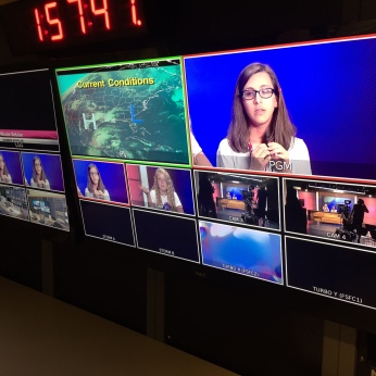 Nicole DeLise looms large in the control room.
