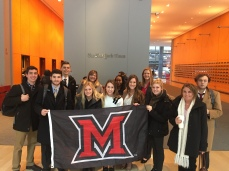 Students fly the flag for Miami in the lobby of The New York Times.