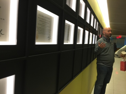 Miami grad David Marino-Nachison shows off Dow Jones's Pulitzer Prizes.